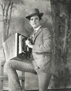 Portrait of young man playing accordion Stock Photos
