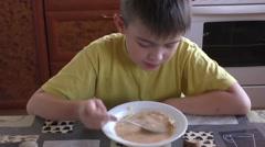 The boy eats a borshch Stock Footage