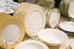 pile stack of clean washed plates - stock photo