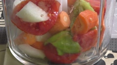 Vegetables are crushed in a blender - stock footage
