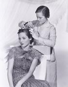 Woman getting her hair done Stock Photos