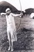 Woman practicing archery - stock photo
