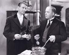 Butler serving salad - stock photo