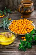 Medicinal the decoction of buckthorn berries - stock photo