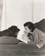 Reading with a loyal friend - stock photo