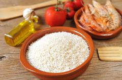ingredients to prepare a spanish paella or arroz negro - stock photo