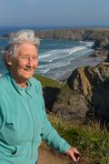 Active elderly female pensioner by Bedruthan Steps Cornwall Stock Photos