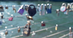 4K - NYC Love Locks (slow motion) on boardwalk wires by the Brooklyn Bridge - stock footage
