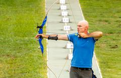 Man archer with a bow. - stock photo