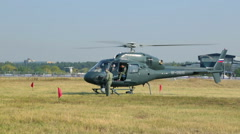 Helicopter Eurocopter AS 355N Ecureuil in the field - stock footage