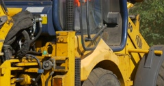 Workers Men in Orange Workwear Are Working Digging Yellow Excavator Close Up Stock Footage