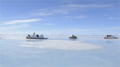 Snowmobile towing a qamutik on sea ice at Admiralty Inlet. - stock footage