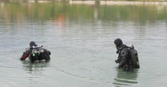 Two Men Divers in Swimsuits Are Standing in The Water Talking Holding the Stock Footage