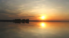 Island on a river at sunset Stock Footage