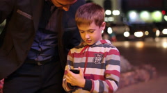 Beautiful little boy smiling and showing the pope to work for smarfone against Stock Footage