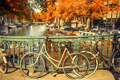Amsterdam canal and bikes Stock Photos