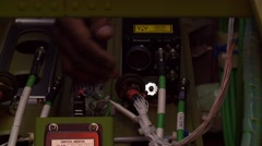 A mechanic inspects wiring in an aircraft. - stock footage
