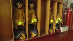 Uniforms hang in cubbies in an airport firehouse. Stock Footage