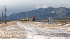 Time lapse of a cargo train passing the Rocky Mountains in Alberta. Stock Footage