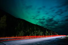 Stock Photo of Highway Traffic Northern Lights Aurora Borealis Alaska Night Sky