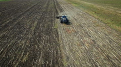 Aerial: Tractor plowing the soil Stock Footage