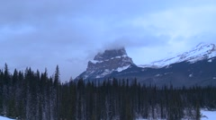 Alberta, Athabasca, Winter Forest and Mountain Landscape - stock footage