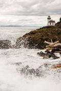 Stock Photo of Waves Crash onto Sharp Rocks Jetty San Juan Island Lighthouse