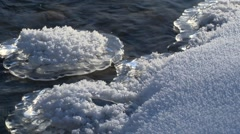 Partially melted ice along the shoreline of the Bow River Alberta, Canada. Stock Footage