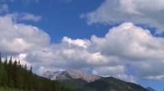 Time lapse of clouds rolling over an Alberta mountain. - stock footage