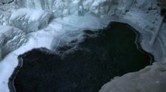 A frozen waterfall in Johnston Canyon, Alberta. (Tilt) Stock Footage