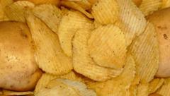 4k – Tubers of fresh potatoes and potato chips Stock Footage