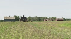 Stock Video Footage of Alberta, Old abandoned farm in the country side 2