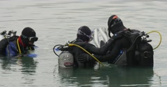 Three Men Divers Close Up Are Standing in The Water Going to Dive Checking Stock Footage