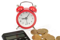 Alarm clock with bills Stock Photos