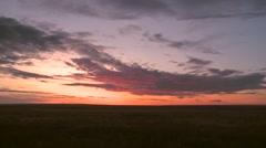 Sun setting over Alberta prairie land. - stock footage