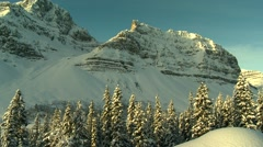 Snow covered Rocky mountains in Alberta. - stock footage