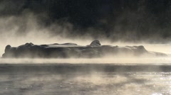 Steam rising from an Alberta river surrounded by snow. - stock footage