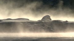Steam rising from an Alberta river surrounded by snow. Stock Footage