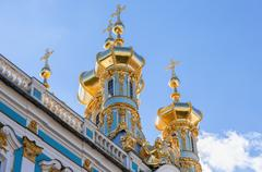 Golden domes of the Church of the Resurrection of Christ against blue sky - stock photo
