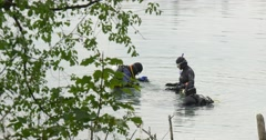 Three Men Divers Are Standing in The Water Going to Dive Men Divers in Swimwear Stock Footage