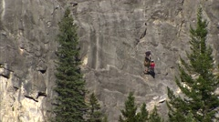 Stock Video Footage of Alberta, Two Rock Climbers on a Mountain