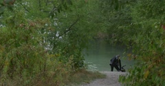 One Man Diver is Walking to The Water Going to Dive Men Divers in Swimwear Stock Footage