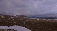 A landscape looking out to mountain ranges in Arctic Bay, Nunavut. (Pan Right) Stock Footage