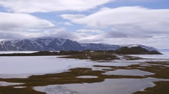 Landscape of mountain ranges and sea-ice in Arctic Bay, Nunavut. (Pan Right) Stock Footage