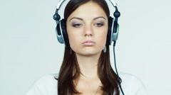 Attractive brunette with headphones lipstick tints Stock Footage