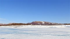 Snowy mountains and sea-ice in an Arctic Bay. - stock footage