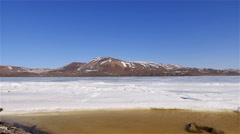 Mountain landscape in Arctic Bay with melting sea-ice along the shoreline. - stock footage