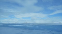 Clouds moving quickly over sea ice in Arctic - stock footage