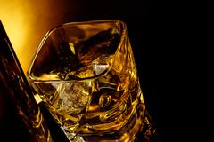 top of view of glass of whiskey near bottle on black table with reflection, w - stock photo