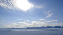 Clouds moving quickly over sea ice in Arctic Bay, Nunavut. - stock footage